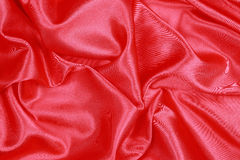 Red Silk cloth of wavy abstract background Royalty Free Stock Photo