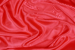 Red Silk cloth of wavy abstract background Stock Photography