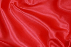 Red Silk cloth of wavy abstract background Royalty Free Stock Images