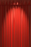 Red silk curtain under spot light Royalty Free Stock Image
