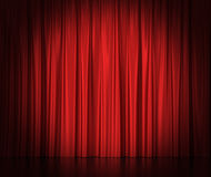 Red silk curtains for theater and cinema spotlit Stock Photography