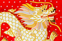 Red silk embroidered dragon art, Myanmar Royalty Free Stock Photos