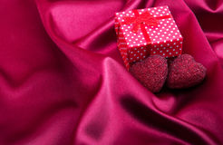 Red silk fabric background and gift box Royalty Free Stock Photo