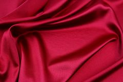 Red silk fabric. Closeup of ripples in red silk fabric Royalty Free Stock Image