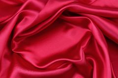 Red silk fabric. Closeup of ripples in red silk fabric Stock Photo