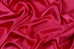 Red silk fabric. Closeup of ripples in red silk fabric Royalty Free Stock Images