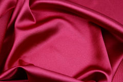Red silk fabric. Closeup of ripples in red silk fabric Royalty Free Stock Photo