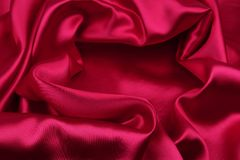 Red silk fabric. Closeup of ripples in red silk fabric Stock Image