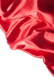 Red silk fabric over white background Royalty Free Stock Photo