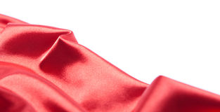 Red silk fabric over white background Royalty Free Stock Photos
