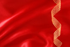 Red silk and golden ribbon Stock Photography