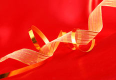 Red silk and golden ribbons Royalty Free Stock Photography