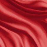 Red silk material background illustration, folds or draped cloth in curves royalty free stock photography
