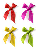 Red silk ribbon bow. Selection of various color silk ribbon knotted bows isolated on white, with realistic soft drop shadows stock photography