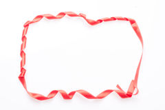 Red silk ribbon, in the form of a frame Stock Photo