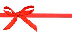 Red silk ribbon. A red silk ribbon long with tied bow Stock Photo