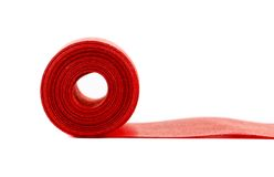 Red silk ribbon roll. Stock Image