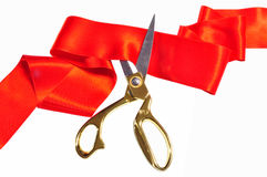Red silk and scissors. Red silk ribbon and scissors isolated on white royalty free stock photography