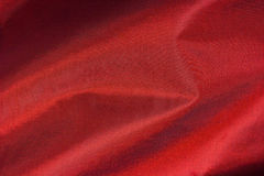 Red silk, textile background Stock Photos
