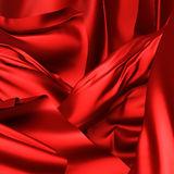 Red silk textile chaotic waves luxury background Royalty Free Stock Image