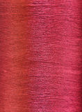 Red silk thread. Texture of red silk thread in spool Royalty Free Stock Photos
