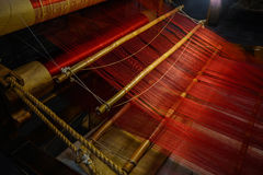 Red silk threads on bobbins of ancient Chinese wooden loom Royalty Free Stock Photos