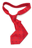 Red silk tie. Curly on white background royalty free stock photo