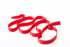 Red silk twisted ribbon in the form Royalty Free Stock Images