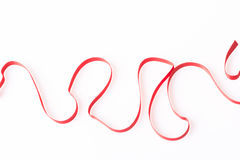 Red silk twisted ribbon in the form Stock Photos