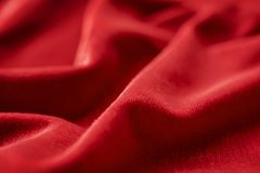 Red silk velvet close up with selective focus Stock Images