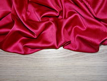 Red silk on a wooden Board Stock Images