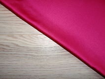 Red silk on a wooden Board stock image
