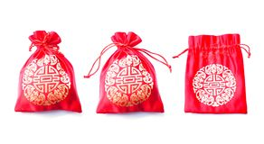 Red silky money bag with Chinese pattern isolated on white backg Royalty Free Stock Photo