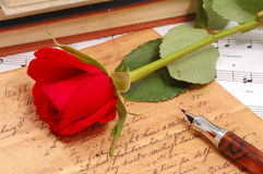 Red silky rose with vintage pen. And letter Royalty Free Stock Photography