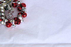 Red and Silver Bell Wreath on White Background Royalty Free Stock Image