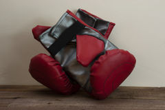 Red and silver boxing gloves Stock Images