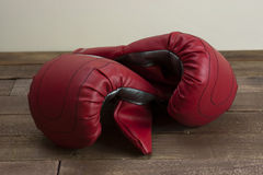 Red and silver boxing gloves Stock Photos