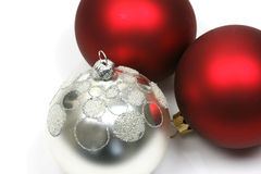 Red and silver christmas balls. Isolated on a white background stock photography