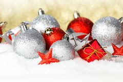 Red and silver christmas balls on snow. Red and silver christmas balls and decoration on snow royalty free stock image