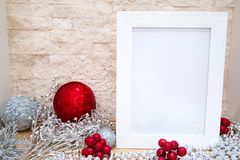 Silver and red Christmas balls with glittering pailletes and dec. Red and silver Christmas balls with glittering pailletes and red berries. Free space for text stock photography