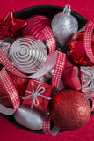 Red and silver Christmas decoration in black bowl Royalty Free Stock Photo