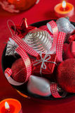 Red and silver Christmas decoration in black bowl Stock Photography