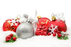 Red,silver christmas decoration on snow Royalty Free Stock Photo