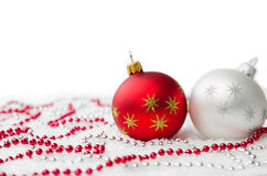 Red and Silver Christmas Decorations with Snow Isolated on White Background. Copy Space. Xmas postcard. Selective focus. Stock Photography