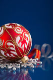 Red and silver christmas ornaments on dark blue background Stock Photography