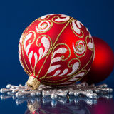 Red and silver christmas ornaments on dark blue background Stock Photos