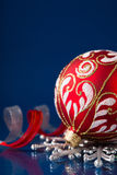 Red and silver christmas ornaments on dark blue background Royalty Free Stock Image
