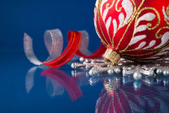 Red and silver christmas ornaments on dark xmas background Stock Photo