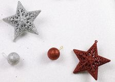 Red and silver christmas stars with glittering white background. Stock Image