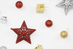 Red and silver christmas stars with glittering white background. Stock Photography